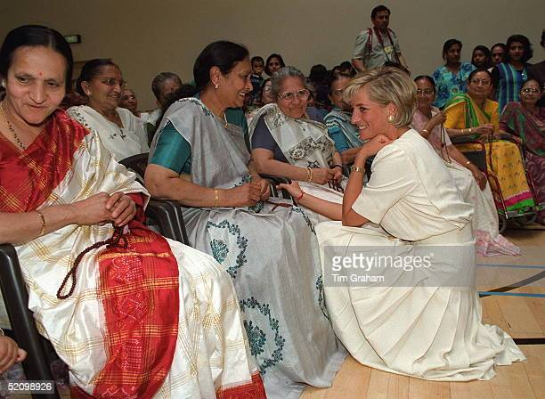 Diana, Princess Of Wales, Crouching Down To Talk To One Of The Ladies At The Shri Swaminarayan Mandir Hindu Temple In Neasden, London Nw10.
