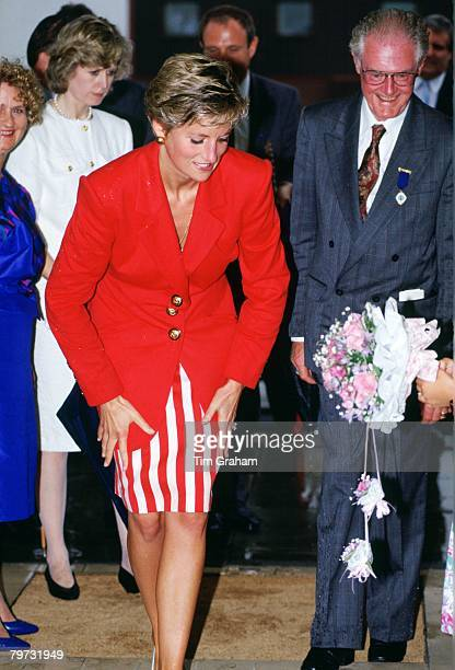 Diana, Princess of Wales dries her hands on her skirt after a walkabout in the rain during a visit to Blackpool