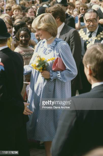 Diana, Princess of Wales during a visit to Deptford in London, May 1982. She is pregnant with Prince William and wearing a maternity dress.