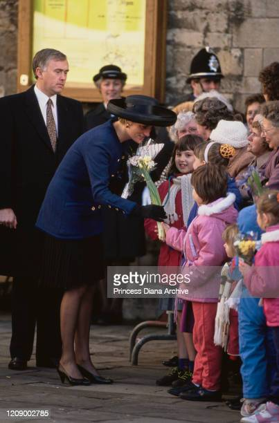 Diana Princess of Wales during a visit to Peterborough UK January 1991 She is wearing a blue suit by Chanel and a black hat