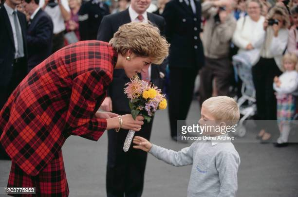 Diana, Princess of Wales during a visit to Tenterden in Kent, 18th October 1990. She is wearing a red and black checked suit by Escada.