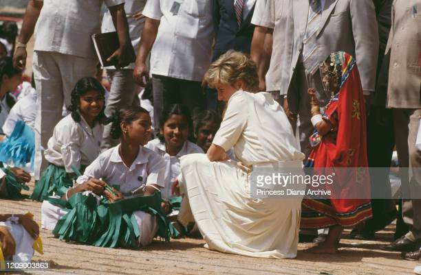 Diana Princess of Wales during a visit to the Lalapet High School in Hyderabad India 14th February 1992 On the right is young dancer Avanti Reddy