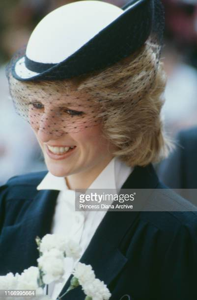 Diana, Princess of Wales during a visit to Warrington in Cheshire, May 1984. She is wearing a maternity coat by Jan van Velden and a hat by Frederick...