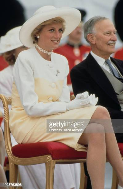 Diana, Princess of Wales during the Presentation of the Colours to the guards at Buckingham Palace, London, May 1990. She is wearing a hat by Philip...