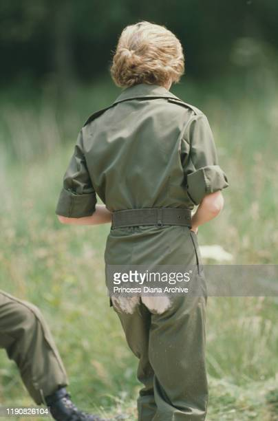 Diana Princess of Wales gets dirt on the seat of her trousers whilst visiting the Royal Hampshire Regiment during manoeuvres at Tidworth in Wiltshire...