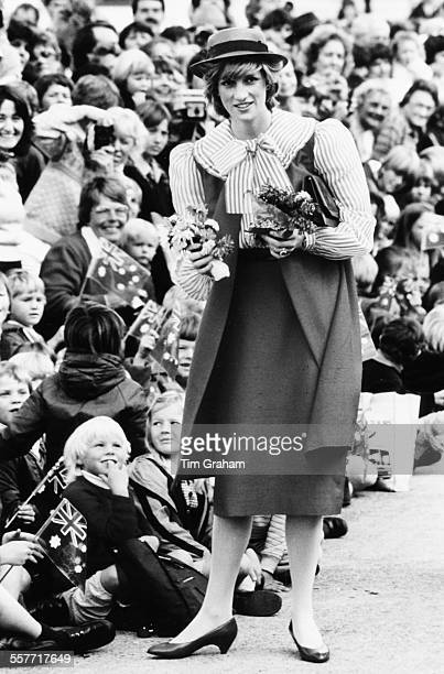 Diana Princess of Wales greeting crowds of children and collecting lots of bunches of flowers from them Hobart circa 1983