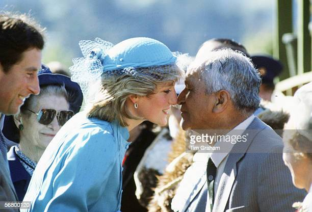 Diana Princess of Wales greets a Maori man with a traditional Hongi rubbing of noses during a walkabout in Wellington New Zealand