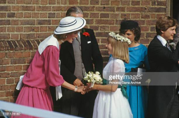 Diana Princess of Wales greets a young bridesmaid at the wedding of Carolyn Pride and William Bartholomew in London September 1982