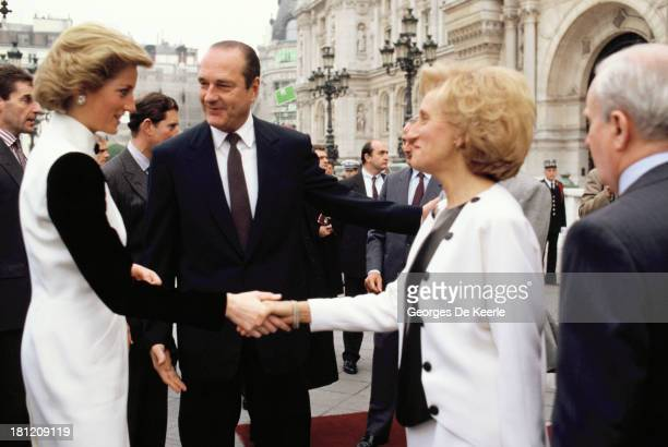 Diana Princess of Wales greets former French President Jacques Chirac and his wife Bernadette Chirac at Hotel de Ville during the official royal...