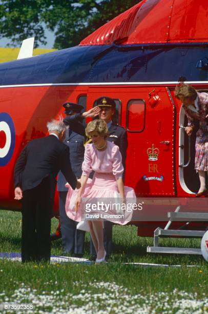 Diana Princess of Wales has a gust of wind blow her skirt up as she gets off her Queens Flight helicopter at the Poolemead centre for the Deaf on May...