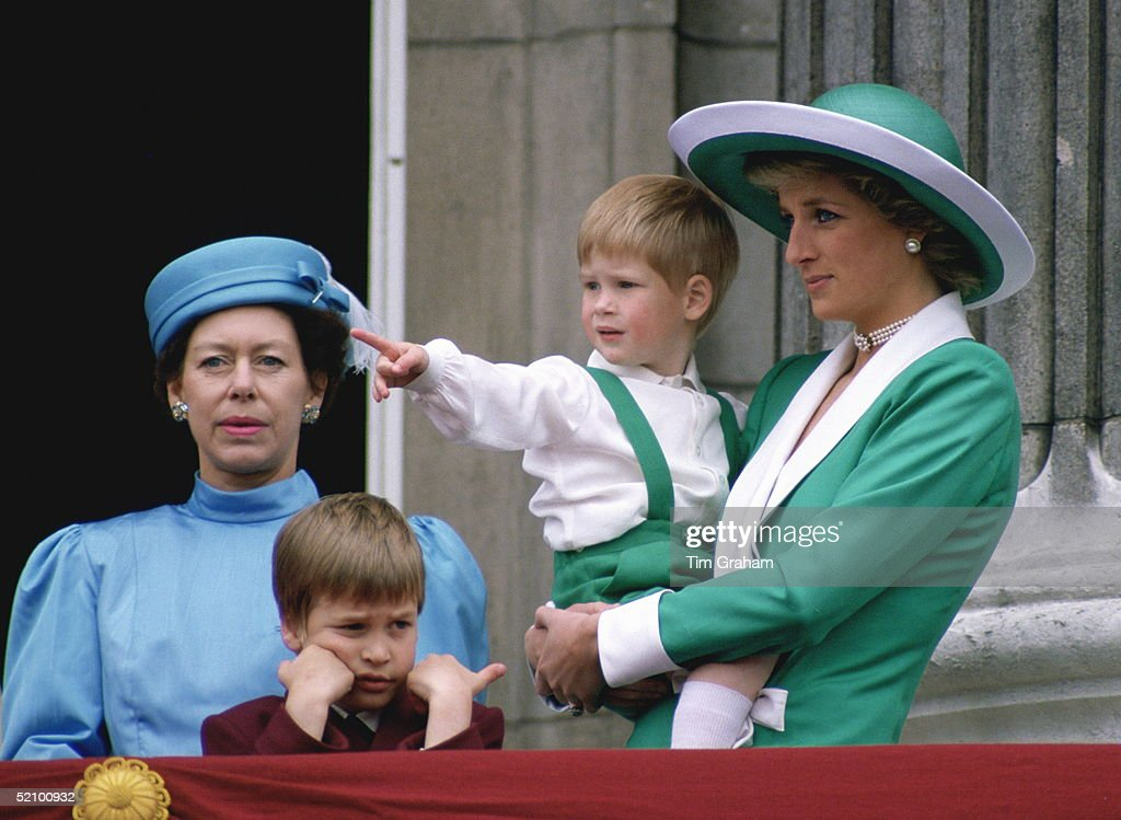 Diana, Princess Of Wales, Holding A Young Prince Harry In Her Arms As She Watches Trooping The Colour With Prince William And Princess Margaret From The Balcony Of Buckingham Palace.