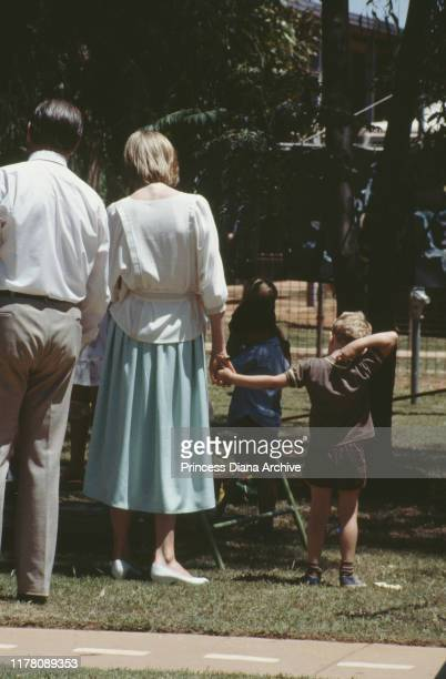 Diana Princess of Wales holding the hand of a small boy during a visit to Tennant Creek in the Northern Territory of Australia March 1983