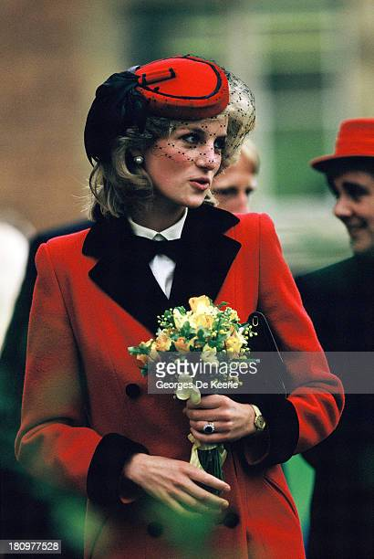 Diana Princess of Wales holds a bouquet of flowers during a visit to The Royal School for the Blind on December 4 1984 in Liverpool England