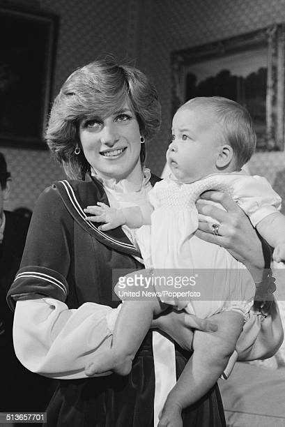 Diana Princess of Wales holds her baby son Prince William at Kensington Palace in London on 22nd December 1982