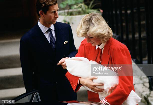 September 16: Diana, Princess of Wales holds Prince Harry as she and Prince Charles, Prince of Wales leave the Lindo Wing at St Mary's Hospital in...