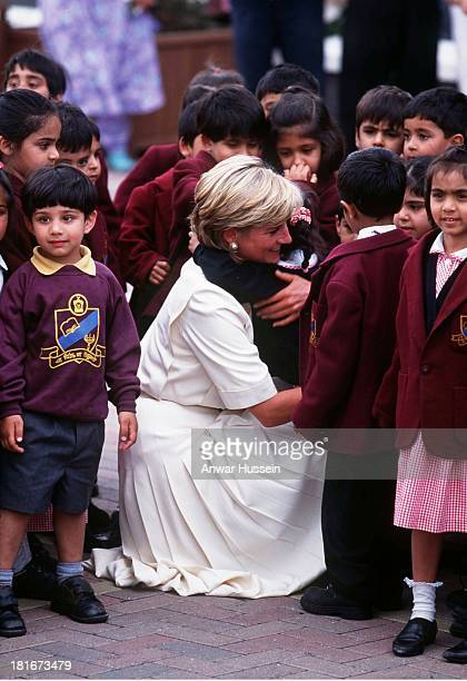 Diana Princess of Wales hugs children during a visit to the Shri Swaminarayan Mandir Hindu Temple on June 06 1997 in Neasden London