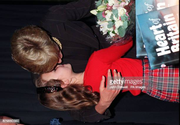 Diana Princess of Wales hugs sevenyearold Danielle Stephenson at the Royal Brompton Hospital's 'Heart of Britain' book launch at the Harrods...