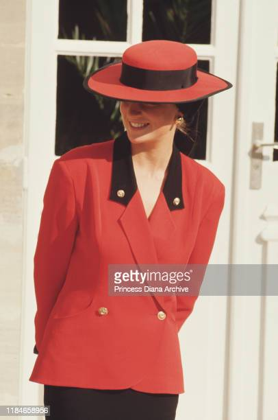 Diana, Princess of Wales in Caen, France, September 1987. She is wearing a red outfit by Rifat Ozbek and a Philip Somerville hat.