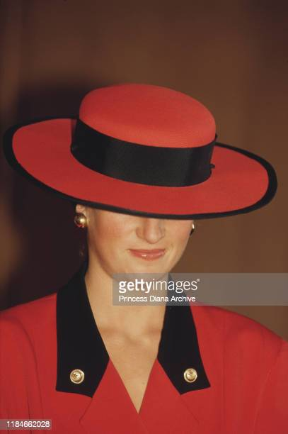 Diana Princess of Wales in Caen France September 1987 She is wearing a red outfit by Rifat Ozbek and a Philip Somerville hat
