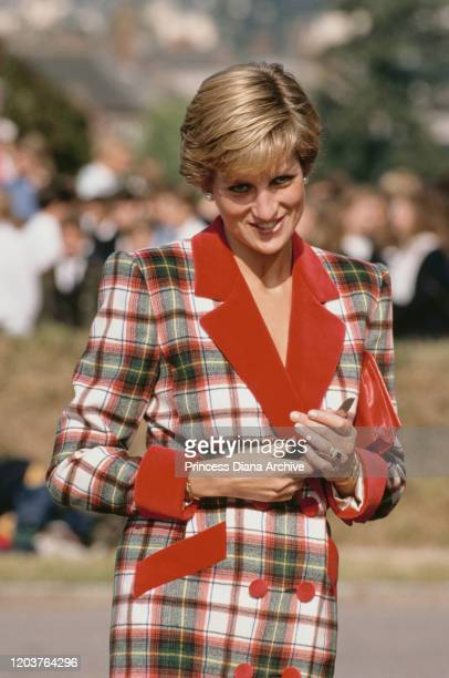 Diana, Princess of Wales in Cullompton, Devon, September 1990. She is wearing a tartan coat-dress by Catherine Walker.