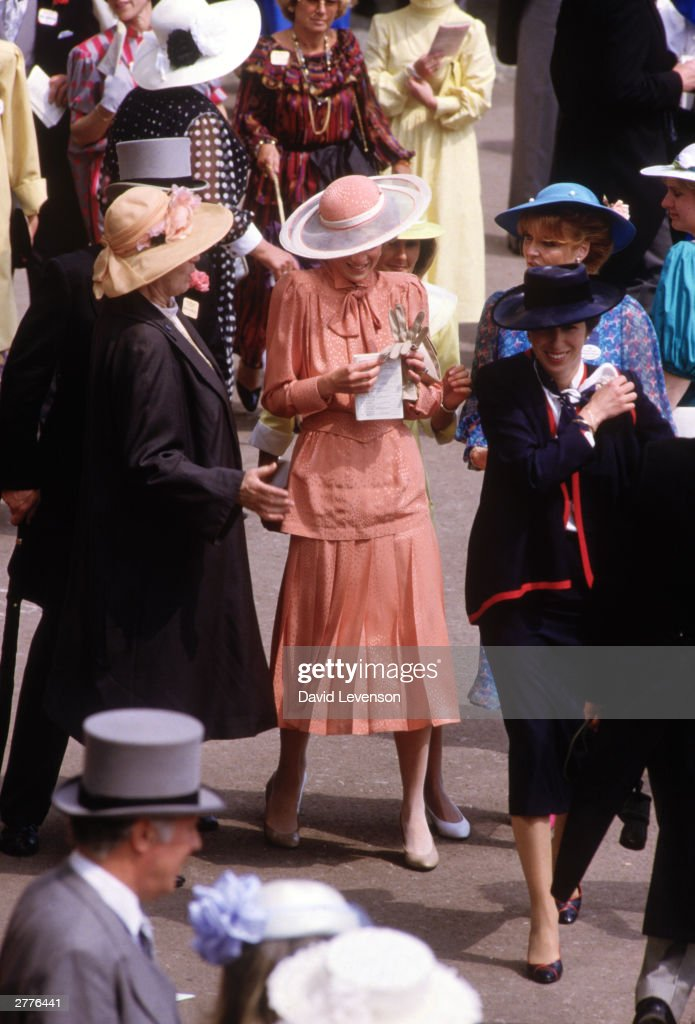 Diana Princess of Wales is bumped into by a woman crossing the Royal Enclosure during Royal Ascot races at Ascot : News Photo