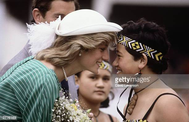Diana Princess of Wales is given the traditional Maori greeting of a nose rub in the Eden Park Stadium on her arrival on April 18 1983 in Auckland...