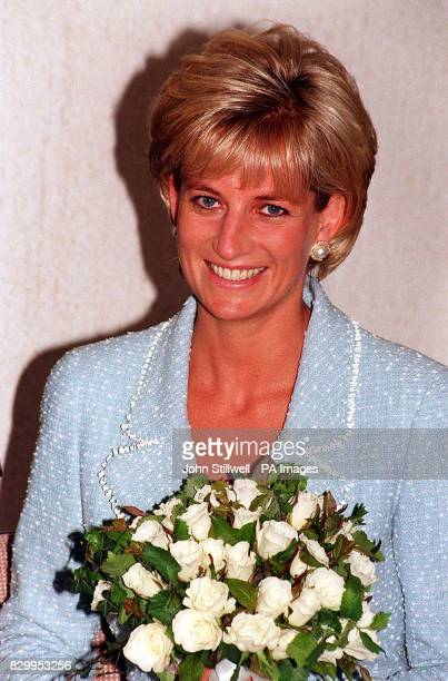 Diana Princess of Wales is presented with the first rose to be named after her at the British Lung Foundation offices in central London today It is...