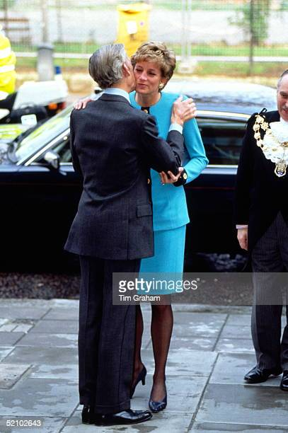 Diana, Princess Of Wales, Kissing The Honourable Angus Ogilvy As They Arrive For Their Visit To The Imperial Cancer Research Fund At Lincoln Inn...