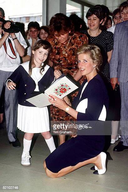 Diana Princess Of Wales Kneeling Down So That She Can Talk With Dawn Charlton At The Peto Institute In Budapest