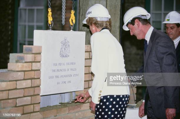 Diana, Princess of Wales lays a ceremonial foundation stone in a wall at the Royal Marsden Hospital in London, 6th June 1990. She is wearing a suit...