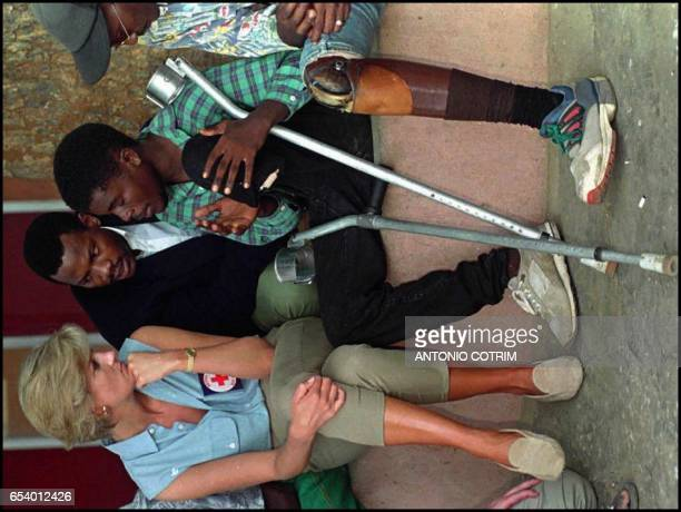 Diana Princess of Wales listens to former Angolan soldiers victims of landmine explosions during 20 years of civil war during a visit at Neves...