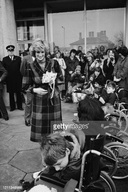 Diana Princess of Wales meeting disabled children during a visit to the head offices of children's charity Dr Barnado's in Barkingside Ilford Essex...