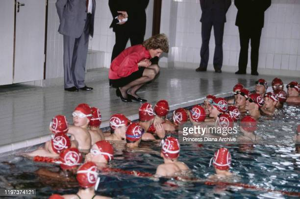 Diana Princess of Wales meets a group of swimmers after opening the Sovereign Leisure Centre on the seafront in Eastbourne in East Sussex UK 30th May...
