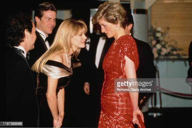 Diana, Princess of Wales meets actors Billy Crystal and Meg Ryan at the premiere of the film 'When Harry Met Sally' in London, UK, November 1989....