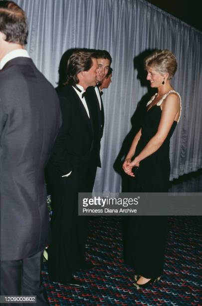 Diana, Princess of Wales meets actors Kurt Russell and William Baldwin at the London premiere of the film 'Backdraft', 22nd July 1991. She is wearing...