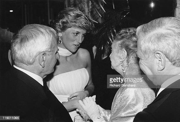 Diana Princess of Wales meets American actress Lillian Gish and director Lindsay Anderson at the Cannes Film Festival in France May 1987 Anderson and...