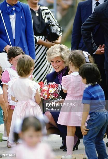 Diana, Princess of Wales meets children from a care home during a walkabout in Australia