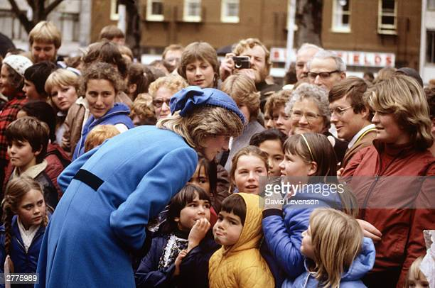 Diana Princess of Wales meets children in the crowd during a walkabout on April 27 1983 through Otago near Dunedin New Zealand during the Royal Tour...