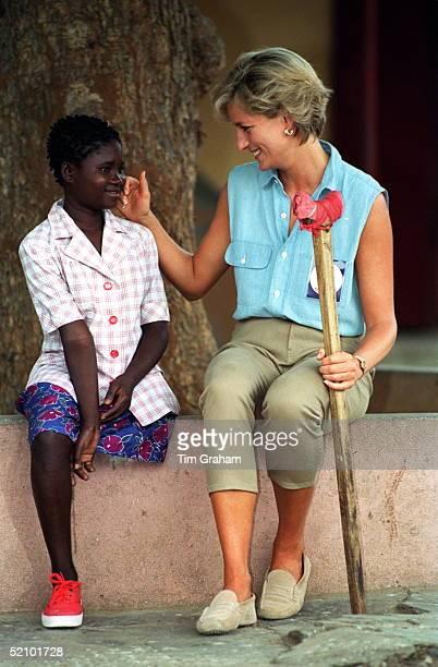 Diana, Princess Of Wales Meets Sandra Thijika At Neves Bendinha, An Icrc Orthopaedic Workshop In Luanda, Angola Durin