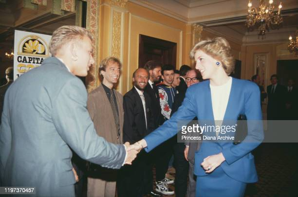 Diana, Princess of Wales meets singer Matt Goss of pop group Bros at the Cafe Royal in London, during a luncheon to launch Capital Radio's Help A...