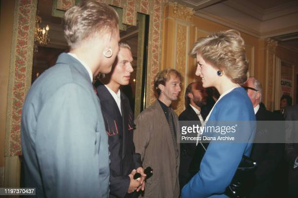 Diana, Princess of Wales meets singers Matt and Luke Goss of pop group Bros at the Cafe Royal in London, during a luncheon to launch Capital Radio's...