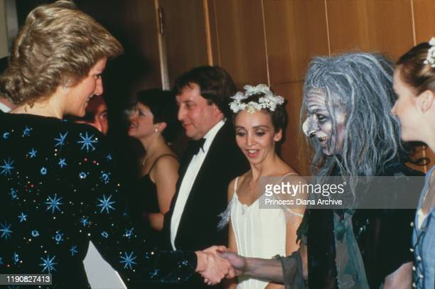 Diana, Princess of Wales meets the cast after a ballet at the Barbican Centre in London, January 1988. She is wearing a dress by Jacques Azagury.