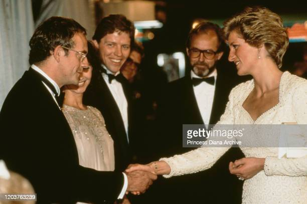 Diana Princess of Wales meets the cast at the premiere of the film 'Back to the Future Part III' in London 10th July 1990 She is wearing a white...