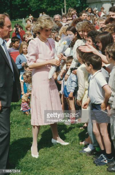 Diana, Princess of Wales meets the public in Bath, UK, wearing a pale pink dress by Catherine Walker, May 1985.