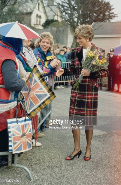 Diana Princess of Wales meets the public in St Austell Cornwall January 1991 She is wearing a tartan coatdress by Catherine Walker