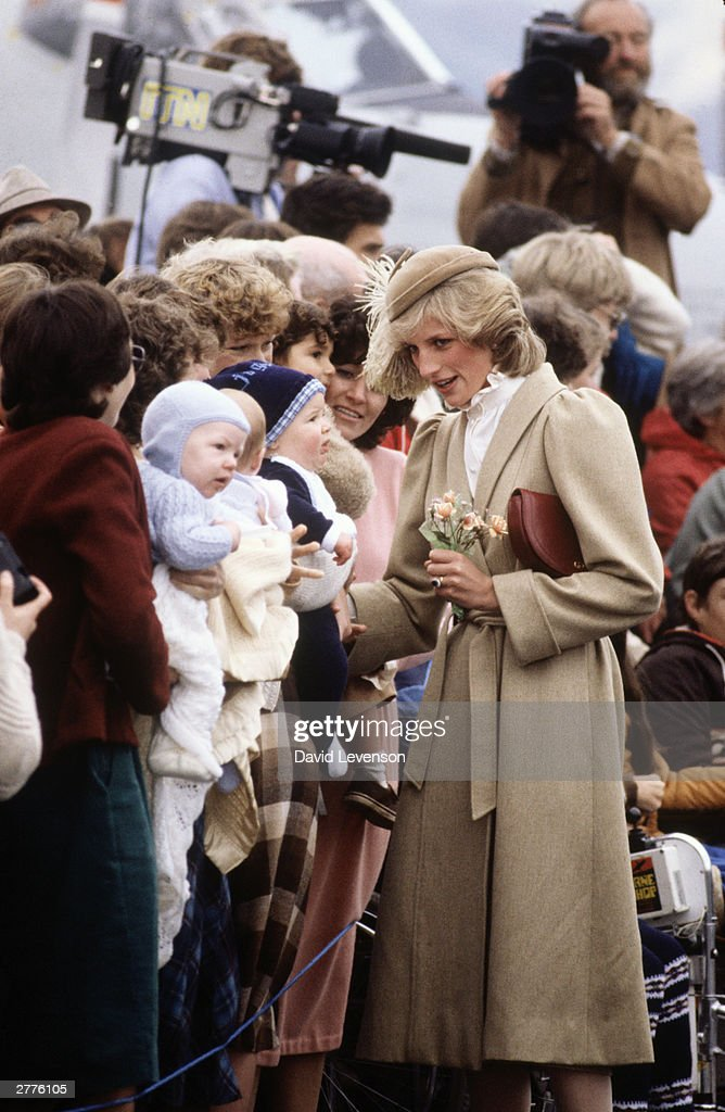 Diana Princess of Wales meets three babies on a walkabout through the city centre of Christchurch, New Zealand : News Photo