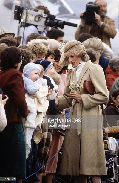 Diana Princess of Wales meets three babies on a walkabout through the city centre of Christchurch on April 28 1983 in New Zealand during the Royal...