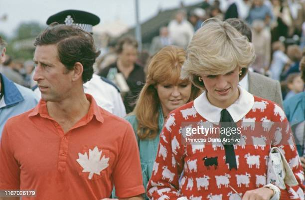 Diana, Princess of Wales , Prince Charles and Sarah Ferguson attend a polo match at Smith's Lawn, Guards Polo Club, Windsor, June 1983. Diana is...