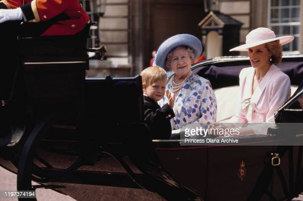 Diana, Princess of Wales , Prince Harry and the Queen Mother in a carriage in front of Buckingham Palace in London during the Trooping the Colour...