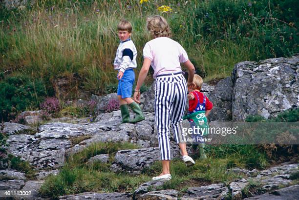 Diana Princess of Wales Prince William and Prince Harry play on the banks of the River Dee near Balmoral Castleduring a Summer vacation on August 18...